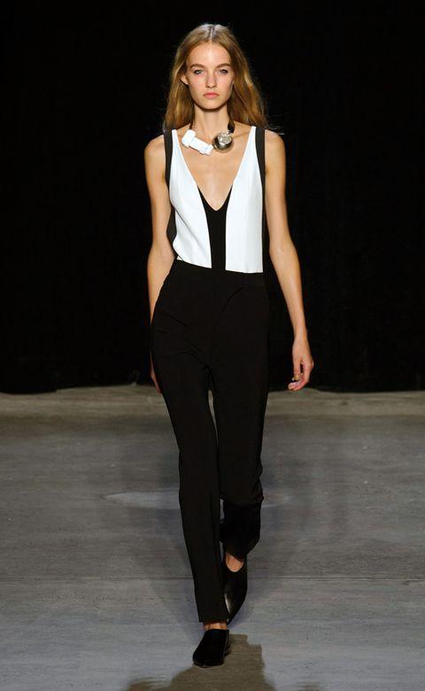 Clothing, Lip, Brown, Sleeve, Human body, Human leg, Shoulder, Joint, Waist, Fashion show,