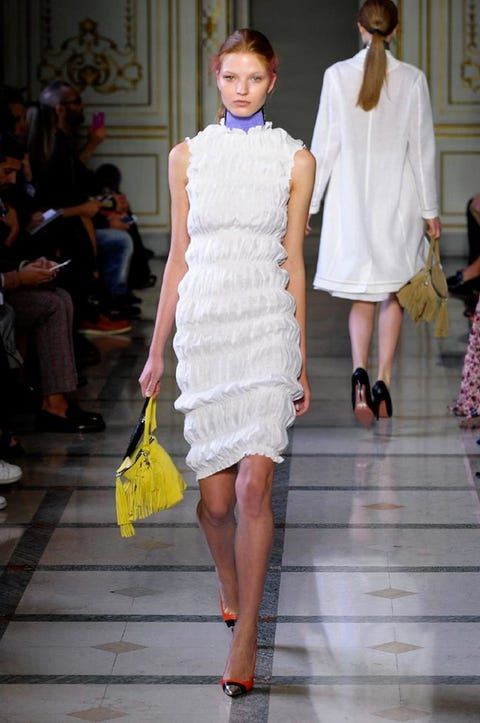 Clothing, Footwear, Leg, Event, Human body, Shoulder, Fashion show, Joint, Outerwear, Dress,