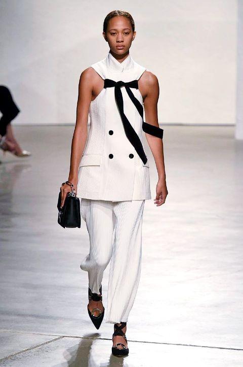 Clothing, Shoulder, Joint, White, Fashion show, Style, Bag, Fashion model, Runway, Street fashion,