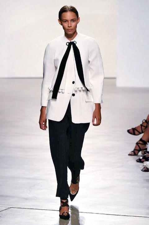 Clothing, Footwear, Leg, Dress shirt, Collar, Sleeve, Trousers, Shoulder, Shirt, Fashion show,