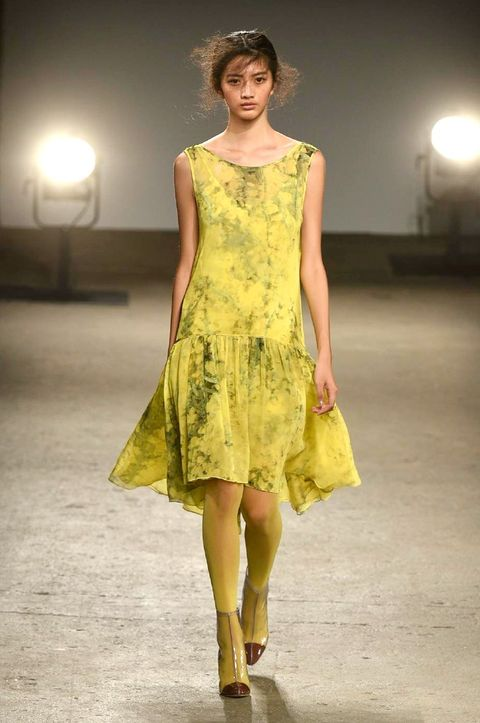 Clothing, Lighting, Yellow, Dress, Sleeve, Shoulder, Textile, Joint, One-piece garment, Style,