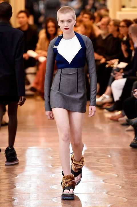 Clothing, Footwear, Leg, Human, Brown, Human body, Fashion show, Human leg, Joint, Outerwear,