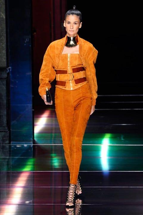 Fashion show, Runway, Style, Amber, Fashion accessory, Fashion model, Fashion, High heels, Jewellery, Orange,