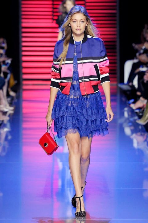 Event, Fashion show, Human leg, Shoulder, Joint, Outerwear, Runway, Dress, Style, Fashion model,