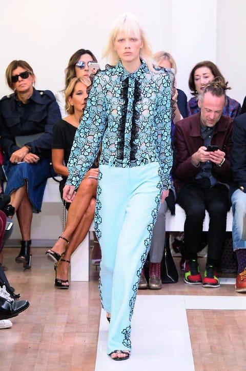 Clothing, Eyewear, Face, Footwear, Leg, Trousers, Outerwear, Style, Coat, Fashion accessory,
