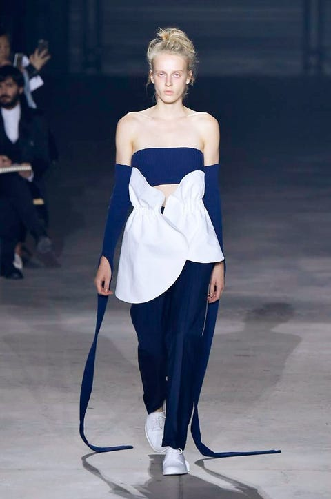 Shoulder, Joint, Standing, Fashion show, Style, Formal wear, Waist, Floor, Fashion model, Electric blue,