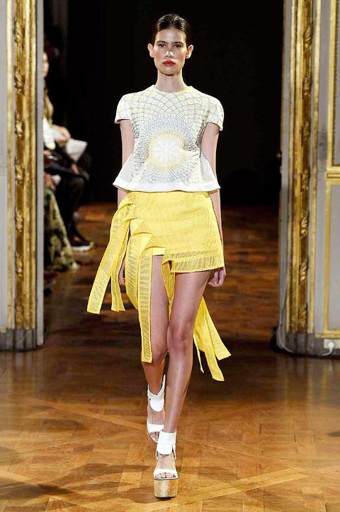 Clothing, Shoulder, Fashion show, Human leg, Joint, Waist, Floor, Style, Runway, Fashion model,