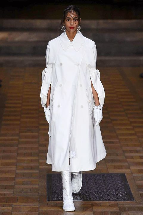 Sleeve, Overcoat, Street fashion, Beige, Fashion model, Trench coat, Frock coat, Costume design, Fashion design, Fur,