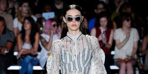 Clothing, Eyewear, Fashion show, Vision care, Runway, Shoulder, Joint, Fashion model, Outerwear, Style,