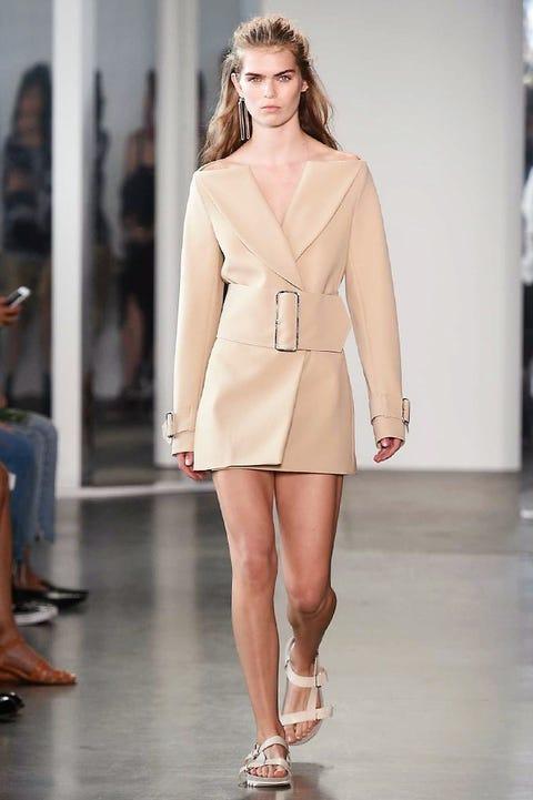 Clothing, Footwear, Leg, Brown, Human leg, Fashion show, Shoulder, Joint, Outerwear, Fashion model,