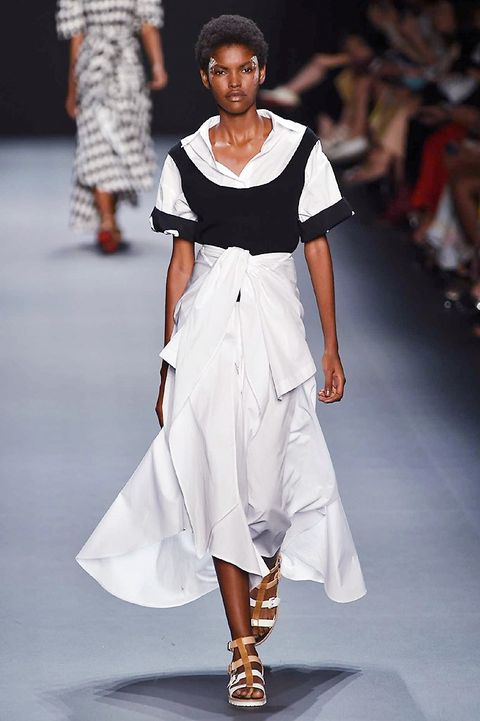 Clothing, Footwear, Fashion show, Shoulder, Joint, Runway, Human leg, White, Fashion model, Style,
