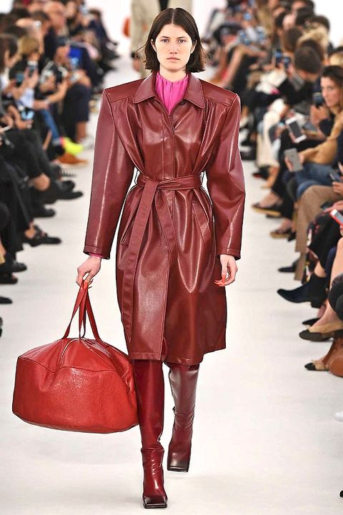 Clothing, Brown, Fashion show, Textile, Red, Outerwear, Runway, Style, Fashion model, Bag,