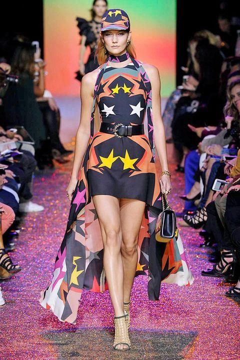 Footwear, Face, Leg, Fashion show, Shoulder, Runway, Joint, Human leg, Outerwear, Style,