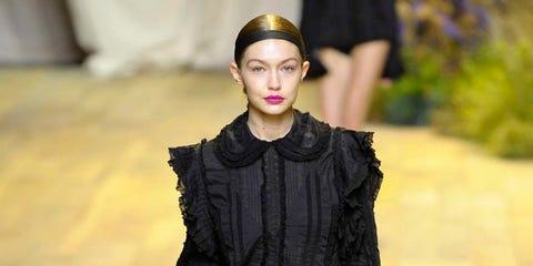 Fashion model, Fashion show, Fashion, Clothing, Runway, Shoulder, Footwear, Public event, Fashion design, Human,