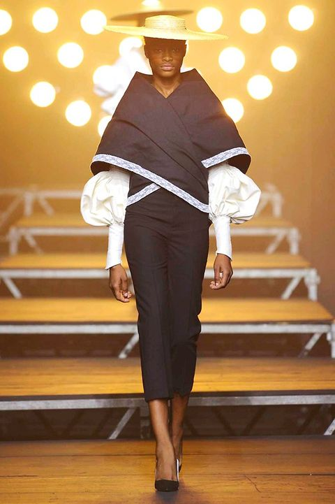 Outerwear, Hat, Style, Formal wear, Headgear, Fashion, Costume accessory, Suit trousers, Stairs, Costume design,