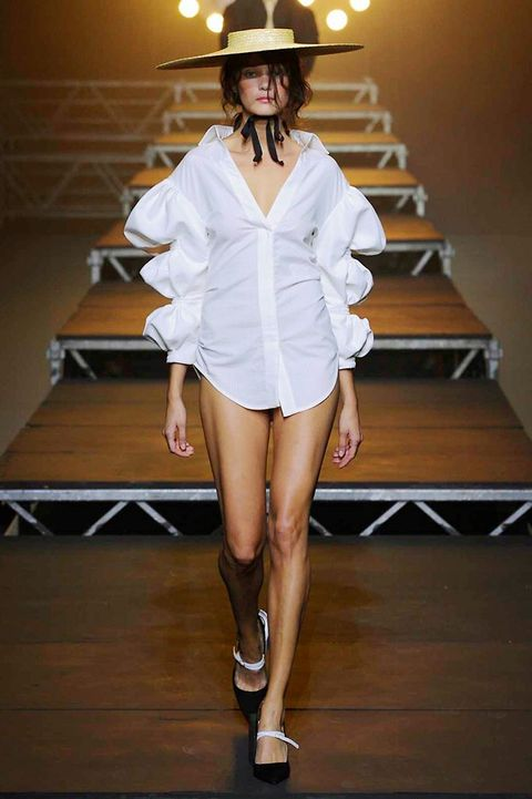 Lighting, Human leg, Outerwear, Fashion show, Fashion model, Style, Hat, Runway, High heels, Stairs,