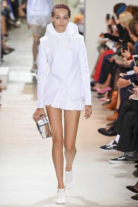 Clothing, Footwear, Leg, Fashion show, Shoulder, Human leg, Joint, Fashion model, Outerwear, Runway,