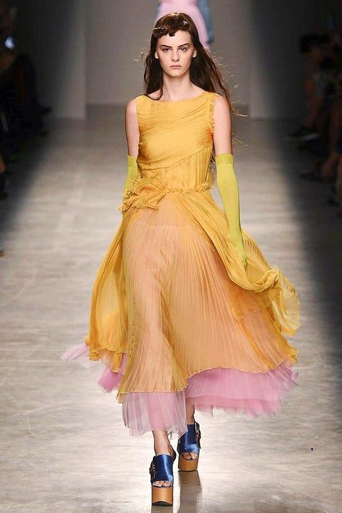 Yellow, Fashion show, Dress, Formal wear, Style, Purple, Fashion model, Fashion accessory, Fashion, One-piece garment,