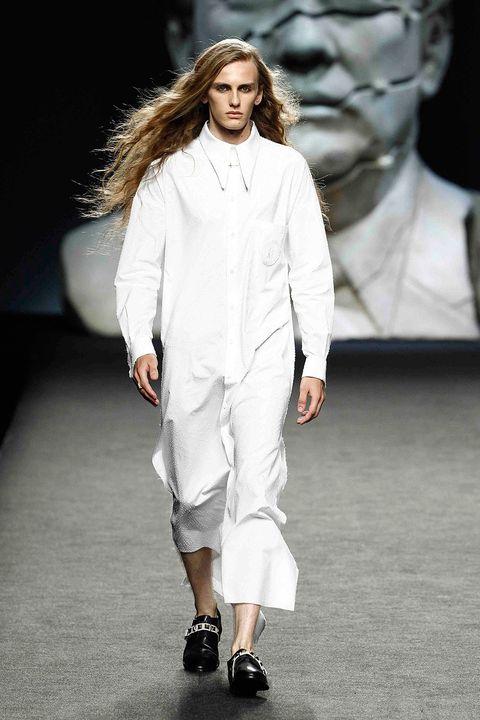Fashion model, Fashion show, Runway, Fashion, White, Clothing, Public event, Human, Neck, Long hair,