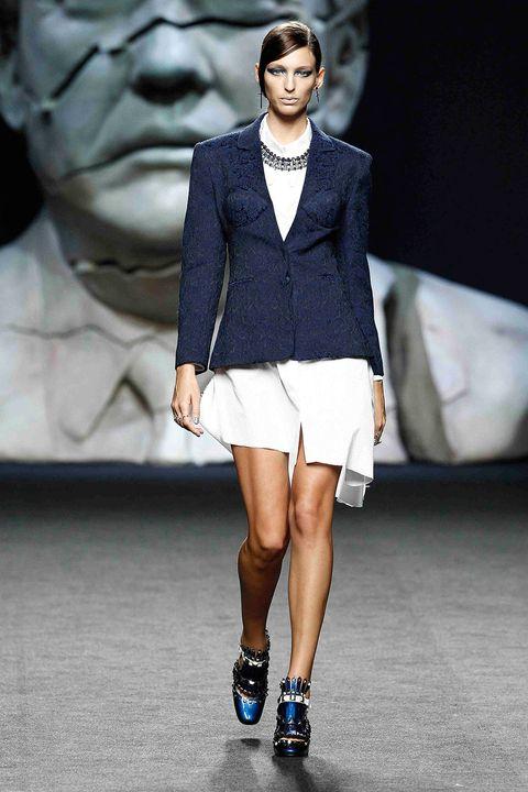 Fashion, Fashion model, Fashion show, Runway, Clothing, Footwear, Street fashion, Shorts, Outerwear, Human,