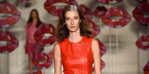 Fashion model, Fashion show, Fashion, Clothing, Runway, Dress, Red, Shoulder, Footwear, Haute couture,