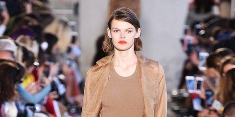 Fashion model, Fashion show, Fashion, Runway, Clothing, Street fashion, Brown, Public event, Event, Beige,