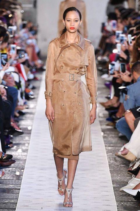 Fashion model, Fashion show, Runway, Fashion, Clothing, Shoulder, Dress, Haute couture, Beige, Event,