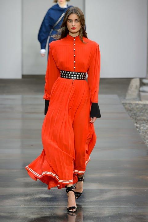 Fashion model, Fashion show, Fashion, Runway, Clothing, Orange, Red, Shoulder, Haute couture, Waist,