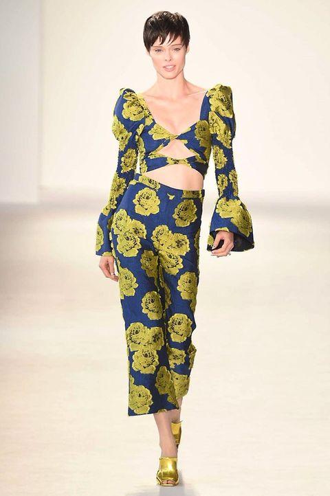 Fashion model, Runway, Fashion, Fashion show, Clothing, Yellow, Shoulder, Fashion design, Joint, Pajamas,