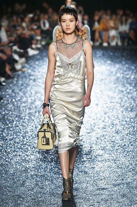 Fashion model, Fashion show, Fashion, Runway, Clothing, Dress, Shoulder, Cocktail dress, Beauty, Fashion design,