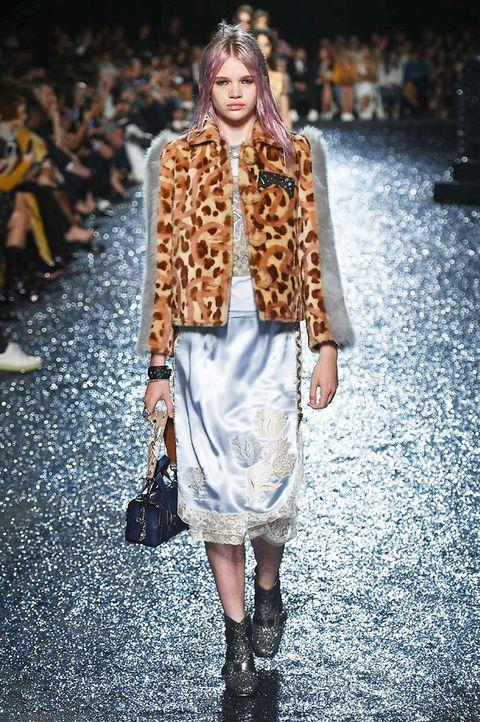 Fashion model, Fashion, Fashion show, Runway, Clothing, Street fashion, Fur, Outerwear, Winter, Footwear,