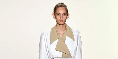 Fashion, Fashion show, Fashion model, Runway, Clothing, White, Beige, Public event, Shoulder, Outerwear,