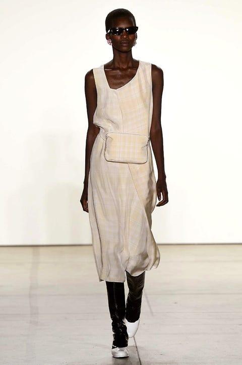 Fashion model, Fashion show, Runway, Fashion, White, Clothing, Shoulder, Fashion design, Dress, Human,