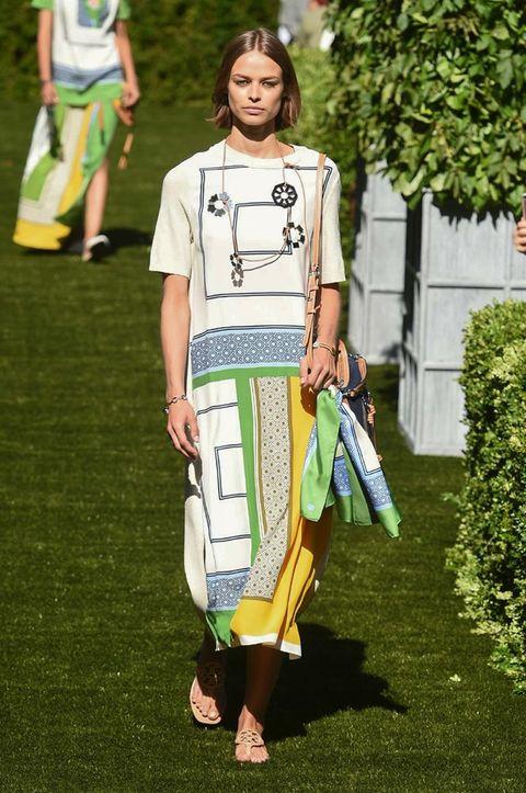 Clothing, Fashion, Street fashion, Shoulder, Grass, Summer, T-shirt, Footwear, Lawn, Fashion design,