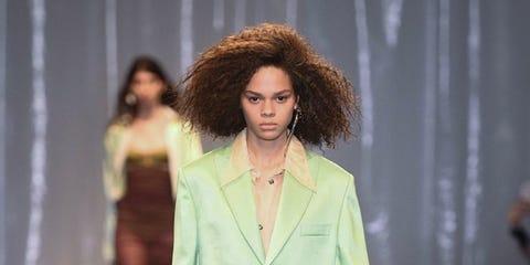 Fashion model, Fashion, Fashion show, Runway, Clothing, Pantsuit, Fashion design, Suit, Public event, Human,