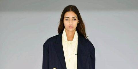 Clothing, Fashion, Fashion show, White, Runway, Outerwear, Fashion model, Coat, Overcoat, Blazer,
