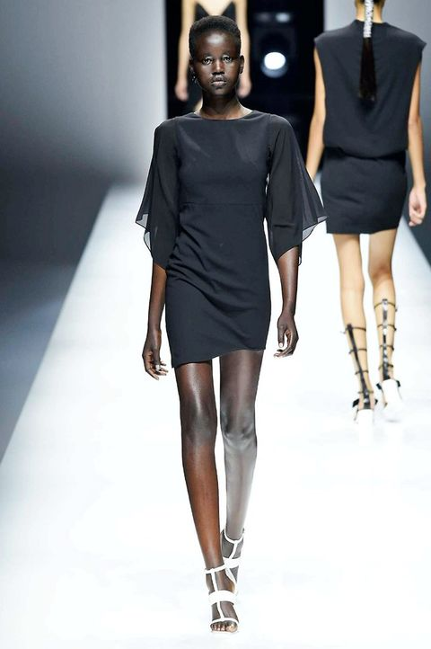 Fashion model, Fashion show, Fashion, Runway, Shoulder, Clothing, Fashion design, Dress, Joint, Little black dress,