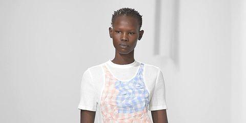 Fashion model, Fashion, Fashion show, White, Runway, Clothing, Shoulder, Fashion design, Knee, Human,