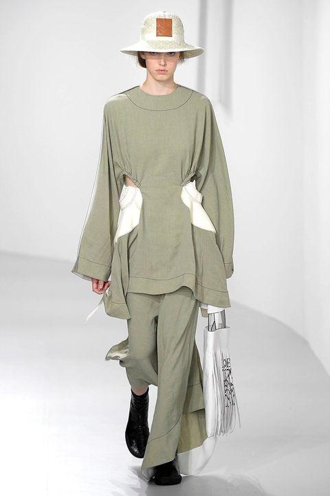 Fashion, Clothing, Fashion model, Fashion show, Runway, Khaki, Fashion design, Shoulder, Outerwear, Joint,
