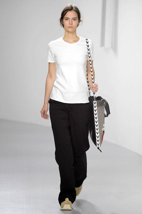White, Fashion, Fashion model, Shoulder, Runway, Fashion show, Clothing, Sportswear, Waist, Joint,