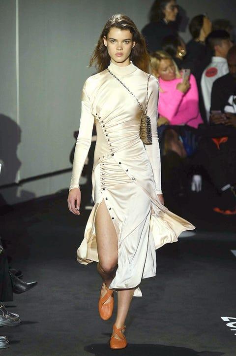 Fashion model, Fashion show, Fashion, Clothing, Runway, Shoulder, Fashion design, Dress, Beauty, Waist,