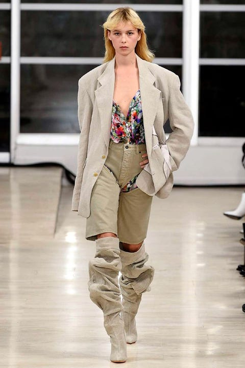 Fashion, Fashion model, Runway, Fashion show, Clothing, Outerwear, Khaki, Blazer, Beige, Shoulder,