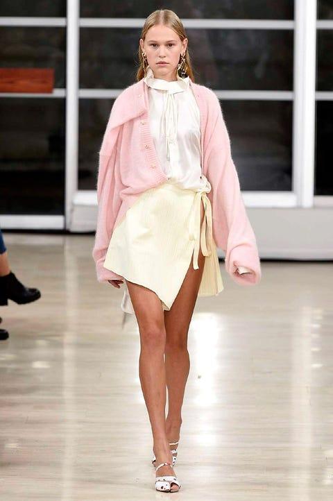 Fashion model, Fashion, Fashion show, Runway, Clothing, White, Shoulder, Public event, Pink, Fashion design,