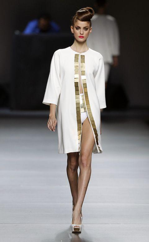 Clothing, Fashion show, Shoulder, Joint, Runway, Human leg, Outerwear, Fashion model, Style, Fashion,