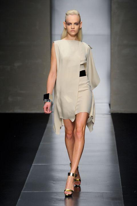 Clothing, Human leg, Shoulder, Fashion show, Joint, Dress, Fashion model, Runway, Style, Sandal,