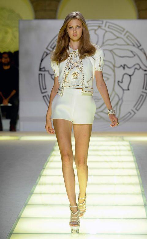 Clothing, Human, Fashion show, Leg, Yellow, Human body, Human leg, Shoulder, Runway, Joint,