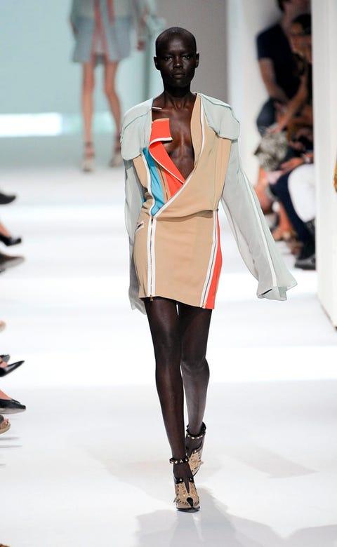 Leg, Brown, Fashion show, Shoulder, Human leg, Runway, Joint, Outerwear, Fashion model, Style,