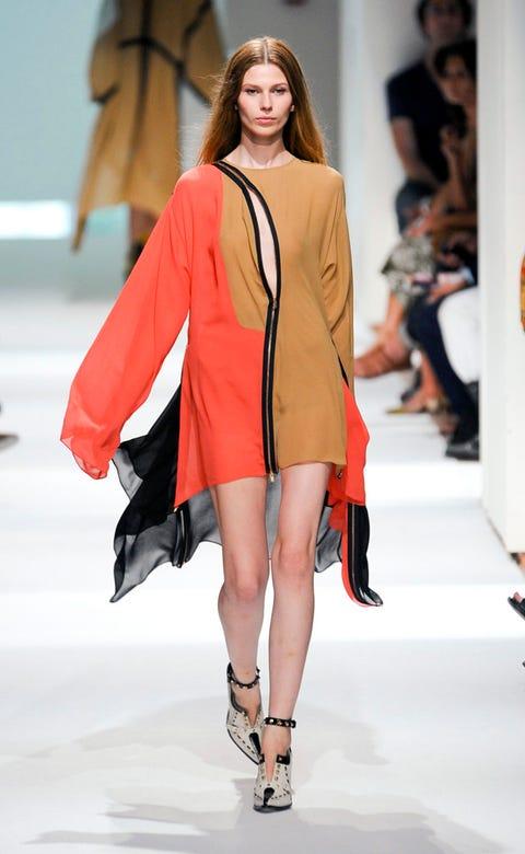 Fashion show, Event, Shoulder, Human leg, Runway, Joint, Outerwear, Fashion model, Style, Fashion,