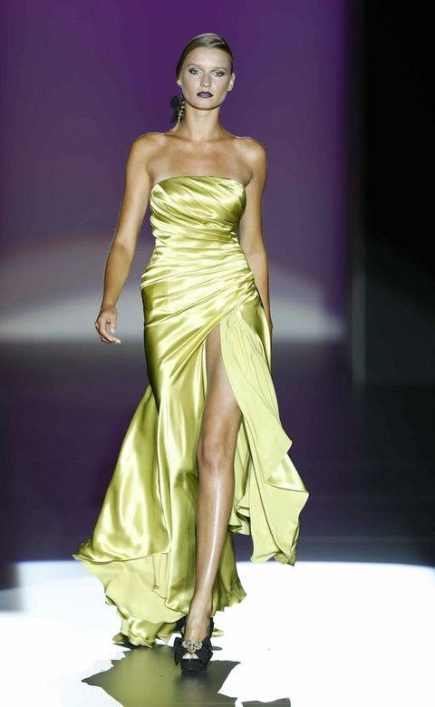 Clothing, Human, Fashion show, Hairstyle, Yellow, Shoulder, Dress, Joint, Fashion model, Formal wear,