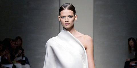 Leg, Skin, Shoulder, Fashion show, Joint, Style, Fashion model, Runway, Dress, One-piece garment,